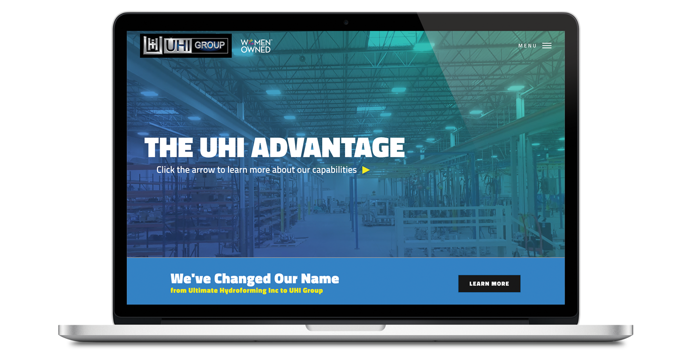 UHI website home page on laptop